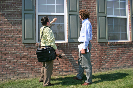 Your Grayslake Home Inspector, AAlert Home Inspection, reviewing window with client